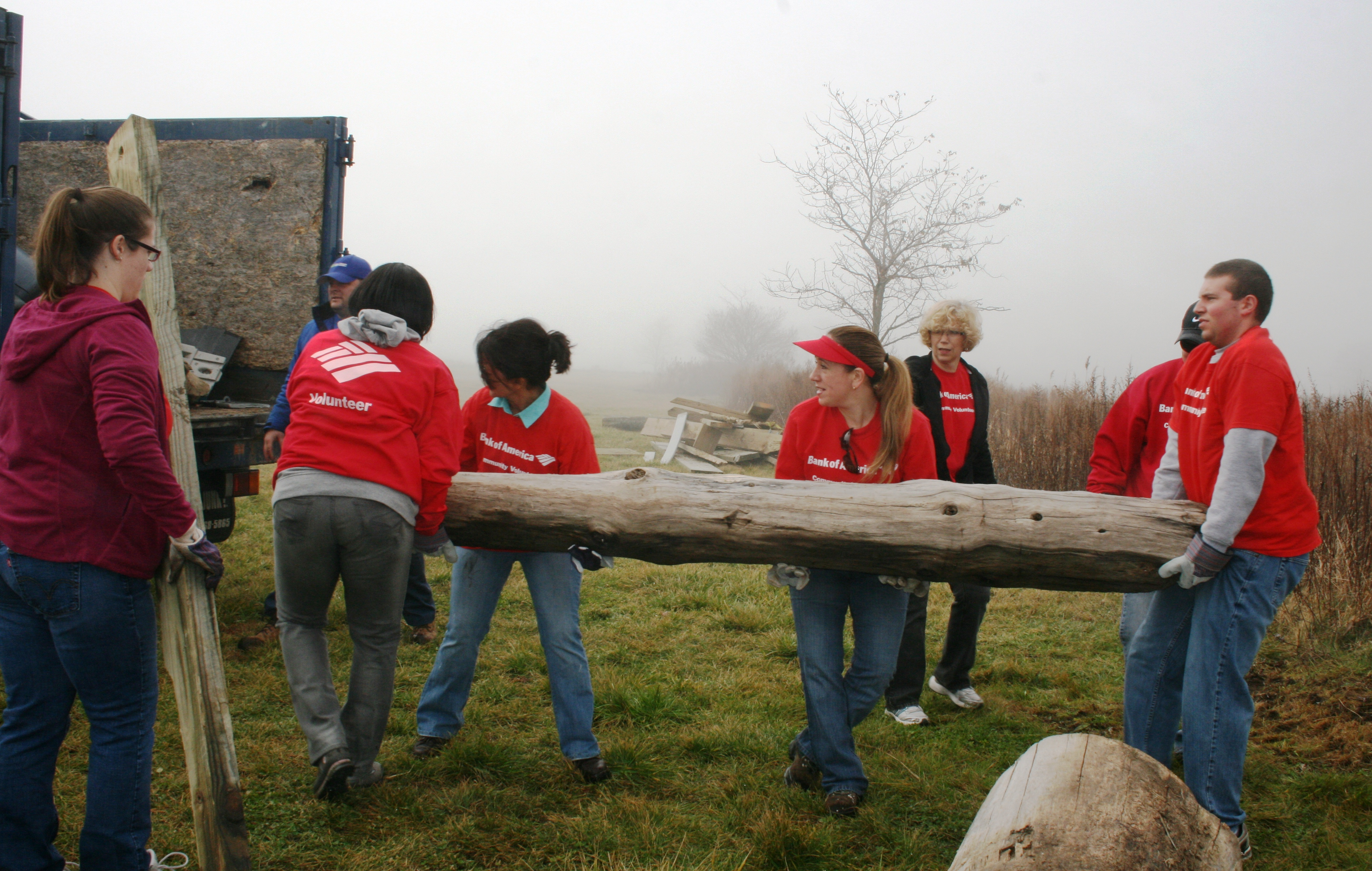 Bank of America volunteers removing debris from Silver Sands after Hurricane Sandy
