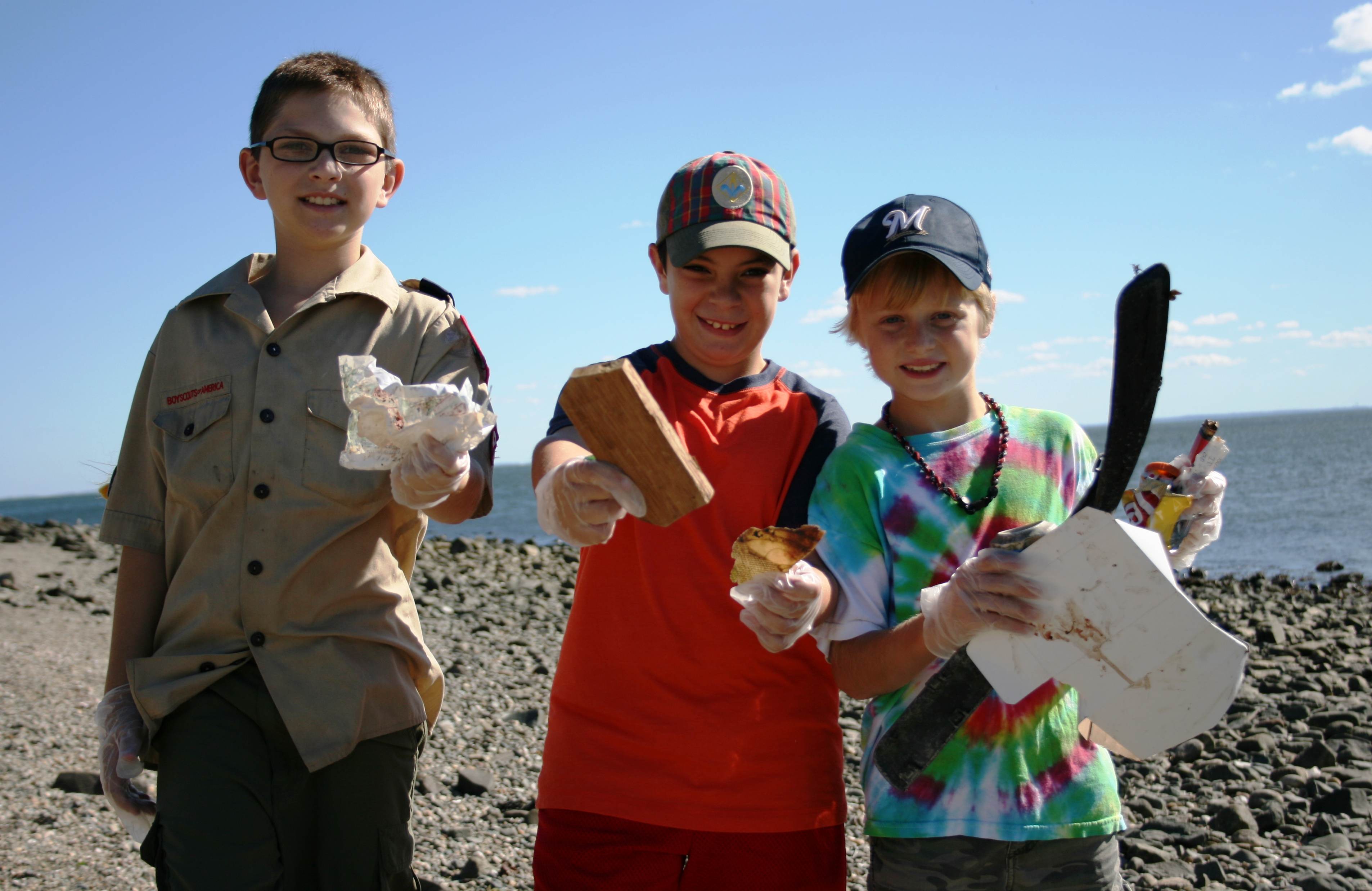 Boy Scouts picking up trash at Gulf Beach in Milford