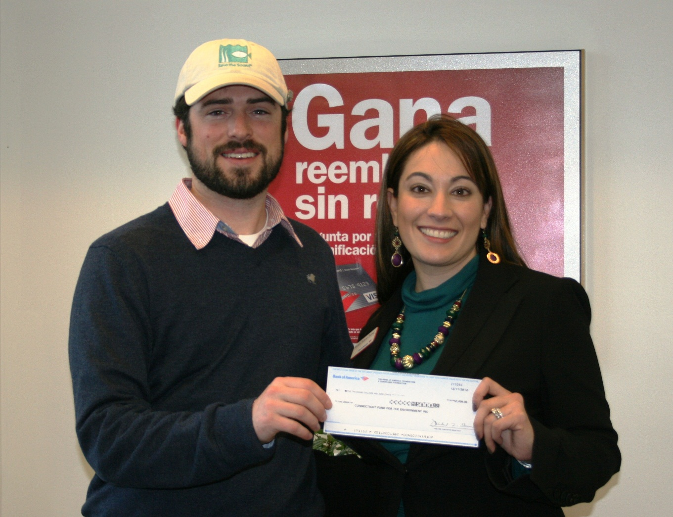 Save the Sound's Kierran Broatch (left) accepts a grant check from Bank of America's Natalia Salazar-Treloar