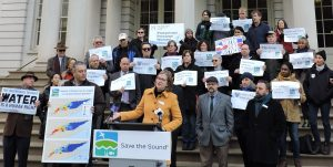 Save the Sound director Tracy Brown and crowd demand clean water in front of NYC City Hall