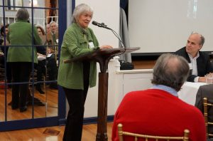Board member Barbara David speaks at a lectern