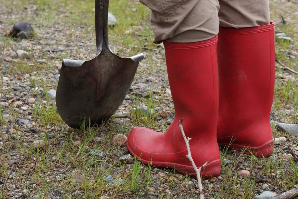 red boots and a shovel, representing our toolbox
