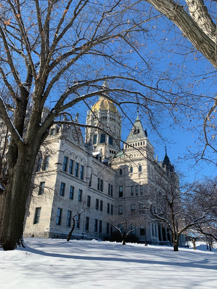 Angled photo of the CT state Capitol building in winter with snow on the ground
